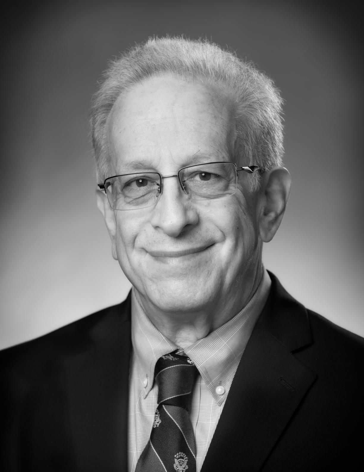Hon. Charles M. Honeyman (Retired)